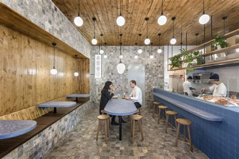 sans arc studio designs an off-beat fish and chip bar with